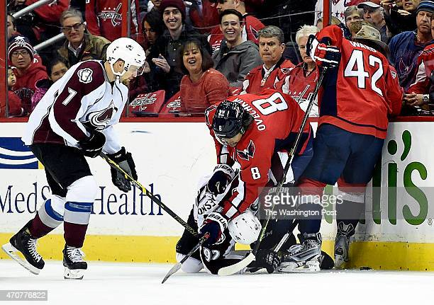 Washington Capitals left wing Alex Ovechkin pushes Colorado Avalanche left wing Gabriel Landeskog to the ice as he and Washington Capitals right wing...