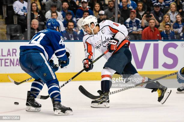 Washington Capitals Left Wing Alex Ovechkin shoots the puck past Toronto Maple Leafs Defenceman Morgan Rielly during the NHL regular season hockey...