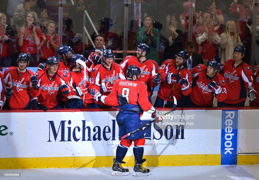 Washington Capitals left wing Alex Ovechkin (8) skates by his team for some handshakes after scoring the lone shootout goal to help beat the New York Islanders 2-1 at the Verizon Center on April 4, 2013 in Washington, D.C.