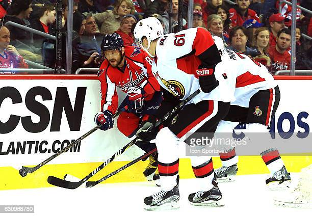 Washington Capitals left wing Alex Ovechkin taps the puck ahead as Ottawa Senators right wing Mark Stone closes in during a NHL game on January 01 at...