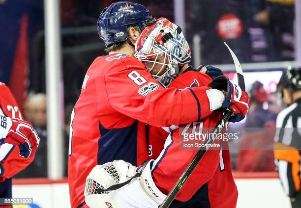 Washington Capitals left wing Alex Ovechkin with goalie Braden Holtby at the end of the NHL game between the Washington Capitals and the Columbus...