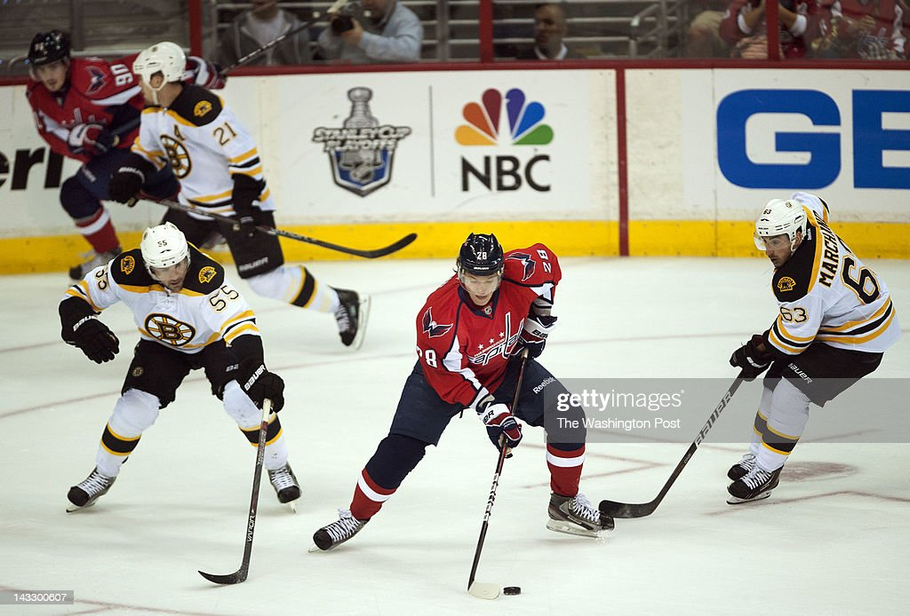 Washington Capitals left wing Alexander Semin (28), center, tries to turn the pouck inbetween Boston Bruins defenseman Johnny Boychuk (55), left, and Boston Bruins left wing Brad Marchand (63), right, during the first period of the game at the Verizon Center on Sunday, April 22, 2012. The Boston Bruins defeated the Washington Capitals 4-3 to send the series back to Boston for game seven.