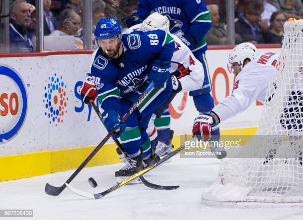 Washington Capitals Left Wing Tom Wilson attempts to check Vancouver Canucks Winger Sam Gagner in a NHL hockey game on October 26 at Rogers Arena in...