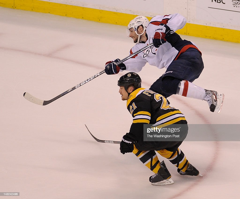 Washington Capitals left wing Troy Brouwer (20) looks at his game winning shot as Boston Bruins defenseman Andrew Ference (21) defends during the third period of game 5 in the Eastern Conference Quarterfinal at TD Garden on April 21, 2012 in Boston, Ma. The Capitals beat the Bruins 4-3.