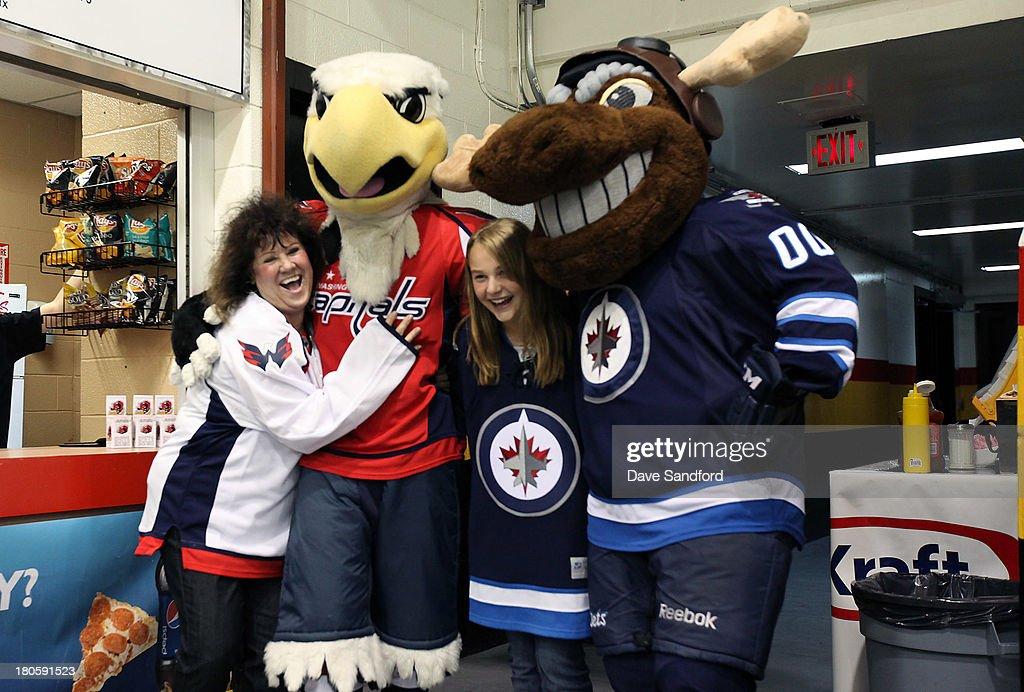 Washington Capitals mascot Slapshot and Winnipeg Jets mascot Mick E. Moose pose with fans during Kraft Hockeyville Day 2 at Yardman Arena on September 14, 2013 in Belleville, Ontario, Canada.