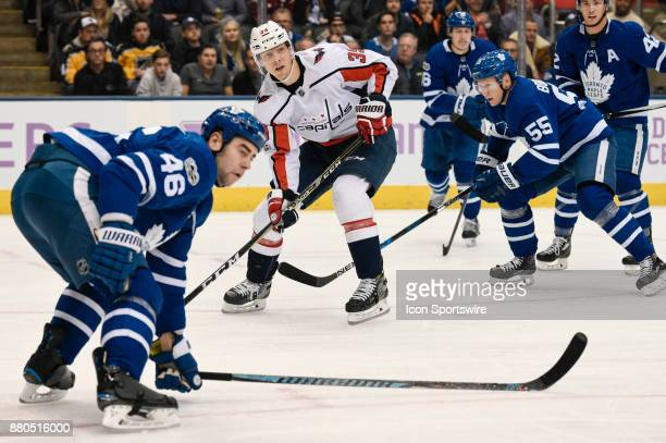 Washington Capitals Right Wing Alex Chiasson looks for room between Toronto Maple Leafs Defenceman Roman Polak and teammate Toronto Maple Leafs...