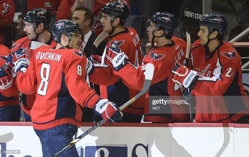 Washington Capitals right wing Alex Ovechkin (8) celebrates his first of two goal against the St. Louis Blues with teammates on the bench in the first period at the Verizon Center in Washington, Sunday, Nov, 17, 2013.