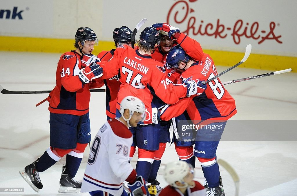 Washington Capitals right wing Alex Ovechkin (8) celebrates with teammates after scoring the team's second goal against the Montreal Canadiens in the third period at the Verizon Center in Washington, Friday, Nov 22, 2013. The Canadiens defeated the Capitals, 3-2.