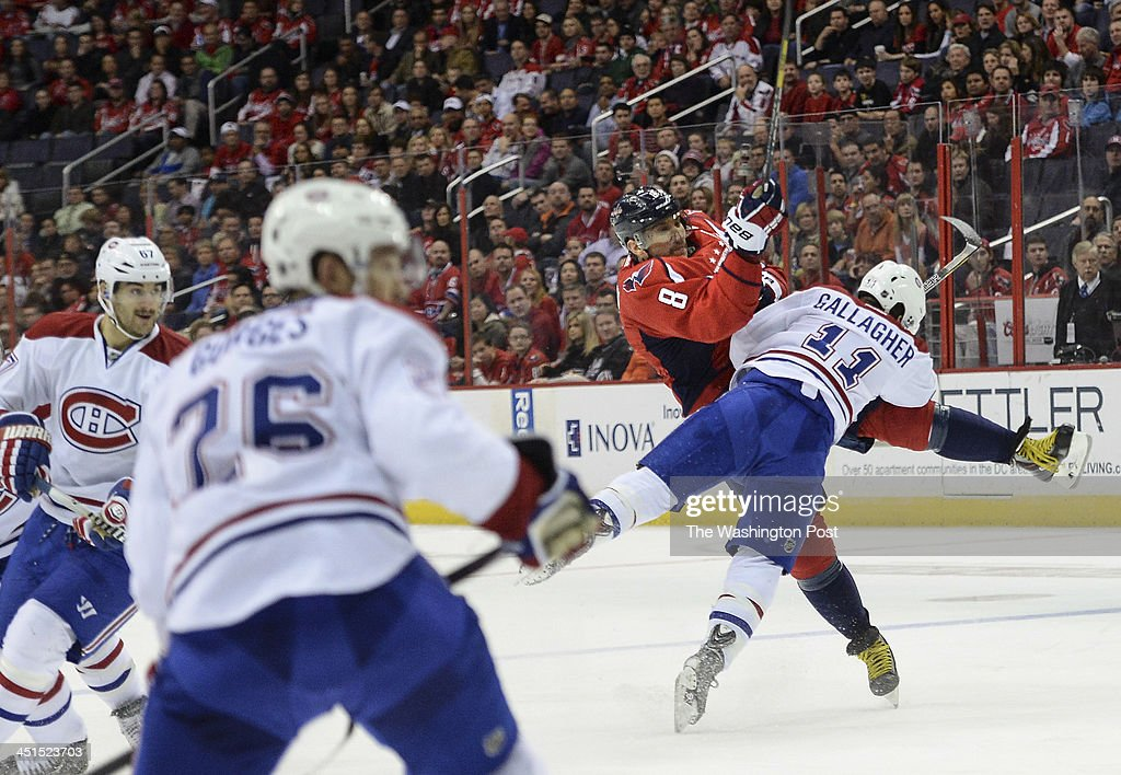 Washington Capitals right wing Alex Ovechkin (8) gets hit by Montreal Canadiens right wing Brendan Gallagher (11) as he shoots the puck during the first period of the game at the Verizon Center on Friday, November 22, 1013.