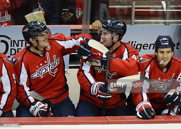 Washington Capitals right wing Alex Ovechkin gives Capitals right wing Tom Wilson a playful tap after Wilson scored his first career goal against the...