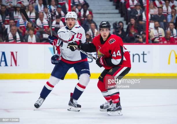 Washington Capitals Right Wing Jakub Vrana and Ottawa Senators Center JeanGabriel Pageau battle for position during the NHL game between the Ottawa...