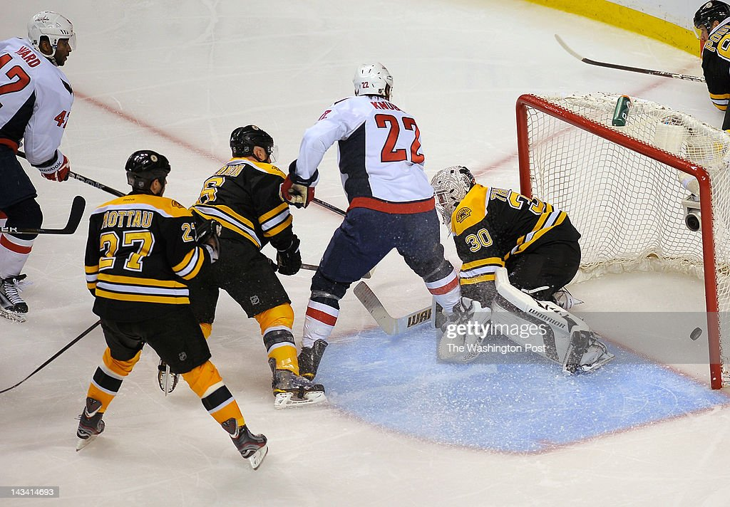 Washington Capitals right wing Joel Ward (42)l eft, scores the game winning shot as the Washington Capitals defeat the Boston Bruins 2 -1 in overtime in game 7 of the first round of the NHL playoffs at the TD Garden in Boston MA. April 25, 2012
