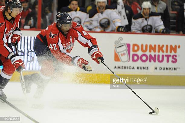 Washington Capitals right wing Joel Ward moves the puck down ice against the Buffalo Sabres during secondperiod action at the Verizon Center in...