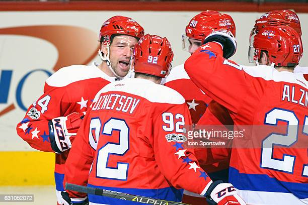 Washington Capitals right wing Justin Williams is congratulated by center Evgeny Kuznetsov after scoring in the third period against the Columbus...