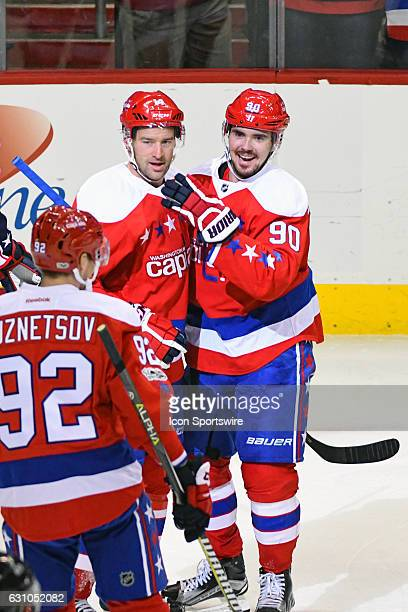 Washington Capitals right wing Justin Williams is congratulated by left wing Marcus Johansson after scoring in the third period against the Columbus...