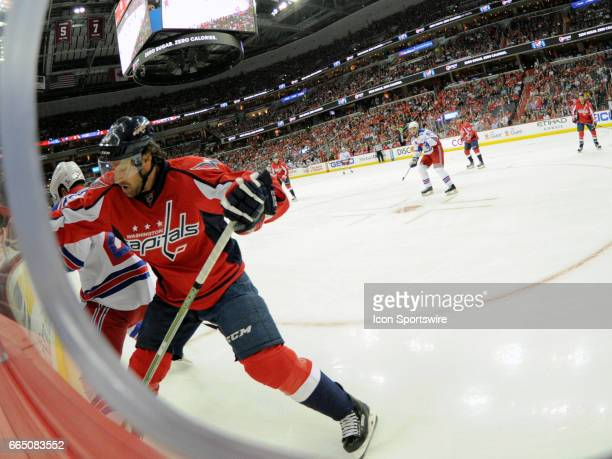 Washington Capitals right wing Justin Williams skates against New York Rangers center Oscar Lindberg on April 5 at the Verizon Center in Washington...