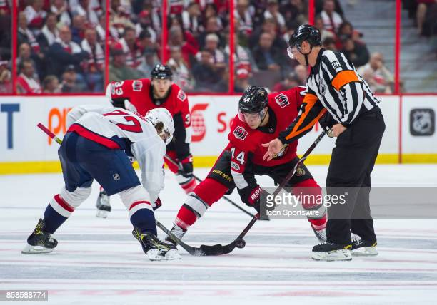 Washington Capitals Right Wing TJ Oshie and Ottawa Senators Center JeanGabriel Pageau battle for the puck at a faceoff during the NHL game between...