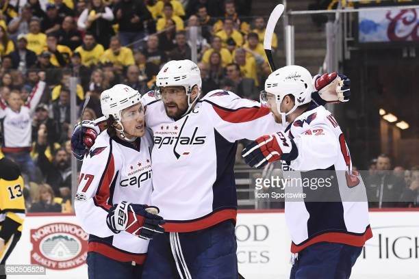 Washington Capitals right wing TJ Oshie celebrates his goal with Washington Capitals left wing Alex Ovechkin and Washington Capitals center Evgeny...