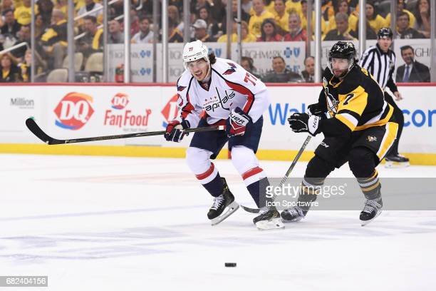 Washington Capitals right wing TJ Oshie moves the puck as Pittsburgh Penguins Center Matt Cullen defends during the first period in Game Six of the...