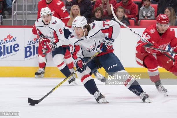 Washington Capitals Right Wing TJ Oshie moves the puck out of his zone in the NHL hockey game between Washington Capitals at Detroit Red Wings on...