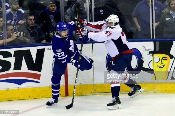 Washington Capitals Right Wing TJ Oshie pushes Toronto Maple Leafs Defenceman Nikita Zaitsev during the second period of the NHL Stanley Cup Playoffs...