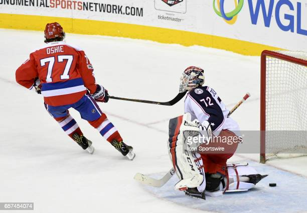 Washington Capitals right wing TJ Oshie scores the only goal in the shootout against Columbus Blue Jackets goalie Sergei Bobrovsky on March 23 at the...