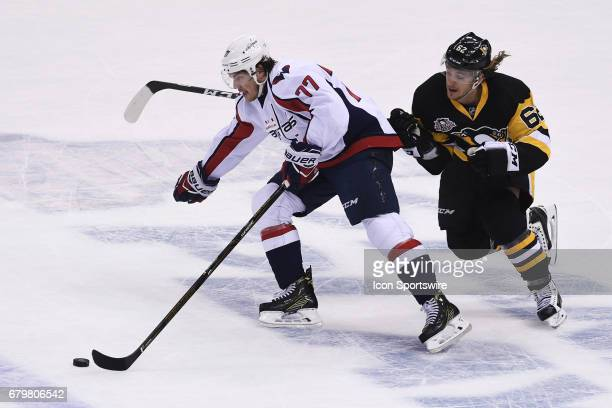 Washington Capitals right wing TJ Oshie skates with the puck as Pittsburgh Penguins Left Wing Carl Hagelin defends during the first period The...