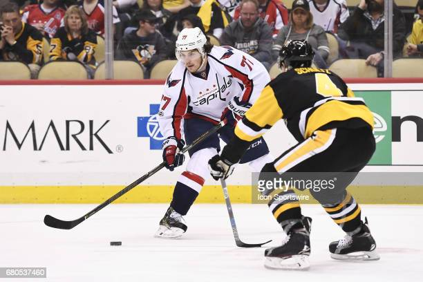 Washington Capitals right wing TJ Oshie skates with the puck in front of Pittsburgh Penguins Defenseman Justin Schultz during the third period in...