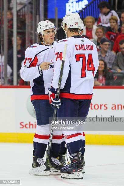 Washington Capitals right wing TJ Oshie talks with teammate Washington Capitals defenseman John Carlson during the National Hockey League game...