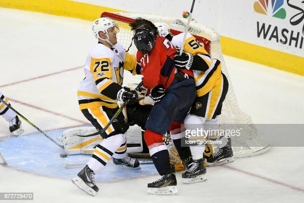 Washington Capitals right wing TJ Oshie tangles with Pittsburgh Penguins right wing Patric Hornqvist and defenseman Kris Letang in the third period...