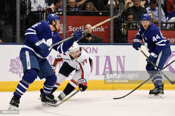 Washington Capitals Right Wing TJ Oshie try to get between Toronto Maple Leafs Defenceman Ron Hainsey and teammate Defenceman Morgan Rielly during...