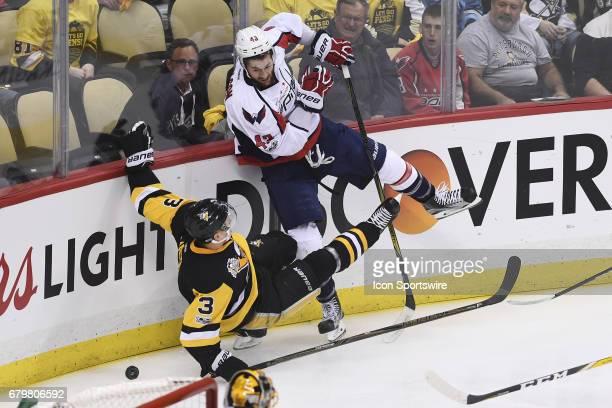 Washington Capitals right wing Tom Wilson checks Pittsburgh Penguins Defenseman Olli Maatta during the first period The Pittsburgh Penguins won 32 in...