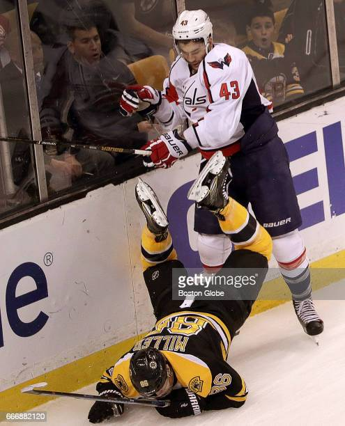 Washington Capitals right wing Tom Wilson delivers a crushing hit on Boston Bruins defenseman Kevan Miller during the first period The Boston Bruins...
