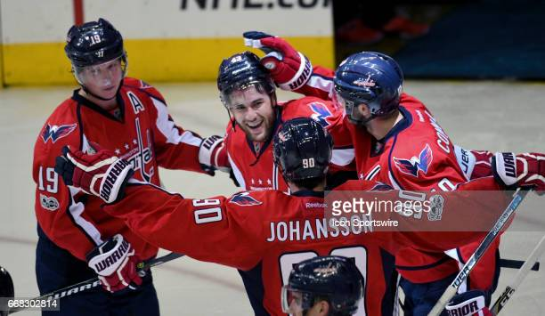 Washington Capitals right wing Tom Wilson is congratulated by the team after scoring the game winning goal in overtime against the Toronto Maple...
