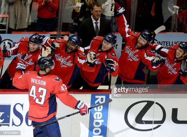 Washington Capitals right wing Tom Wilson is congratulated by teammates Troy Brouwer Joel Ward Alexander Urbom Karl Alzner and Steve Oleksy following...