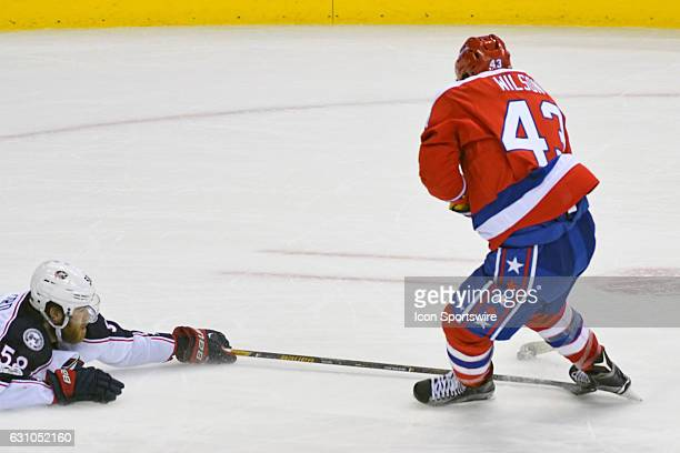 Washington Capitals right wing Tom Wilson is tripped by Columbus Blue Jackets defenseman David Savard in the third period on January 5 at the Verizon...