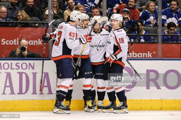 Washington Capitals Right Wing Tom Wilson joins teammates Defenceman Taylor Chorney and Center Nicklas Backstrom in congratulating Left Wing Alex...