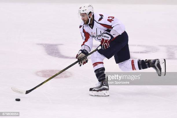 Washington Capitals right wing Tom Wilson skates with the puck during the first period The Pittsburgh Penguins won 32 in Game Four of the Eastern...