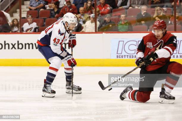 Washington Capitals right wing Tom Wilson's shot is blocked by Arizona Coyotes defenseman Luke Schenn during the NHL hockey game between the...