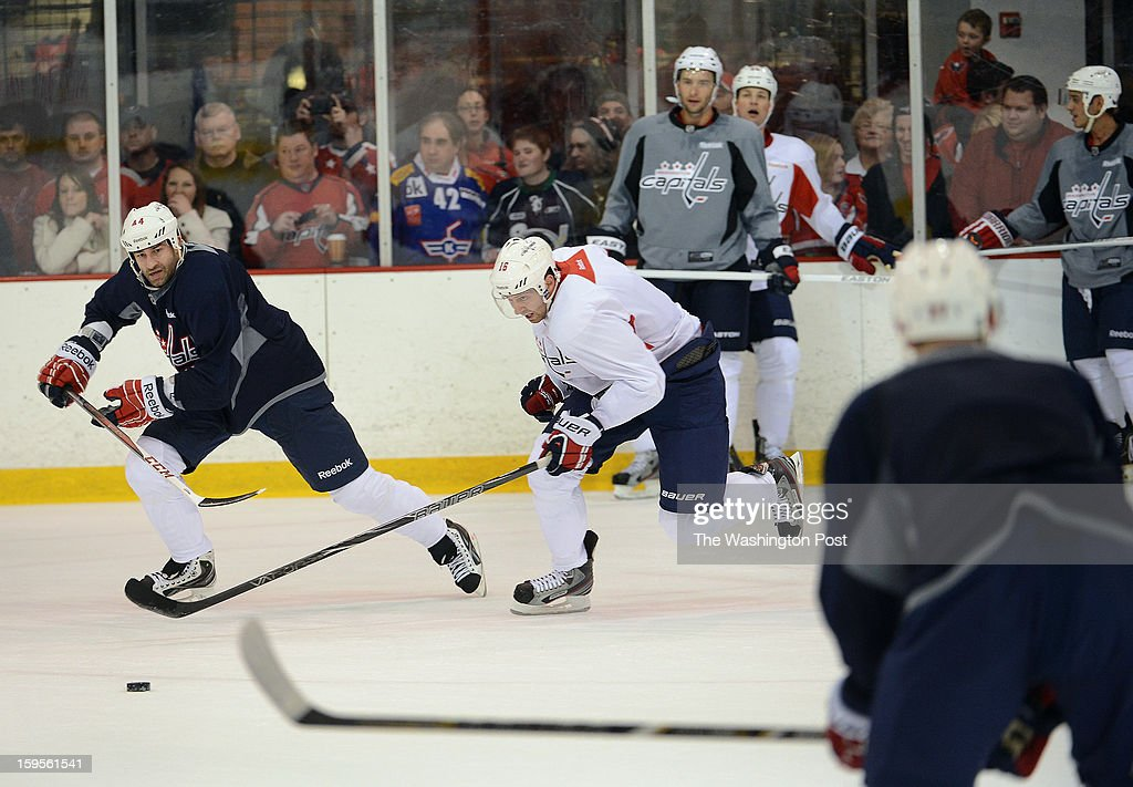 Washington Capitals right winger Eric Fehr, center, chases down the puck during the Washington Capitals' first official practice of the season on Sunday, January 13, 2013.