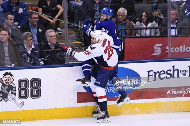 Washington Capitals Winger Daniel Winnik checks Toronto Maple Leafs Defenceman Nikita Zaitsev during Round 1 Game 3 of the NHL Stanley Cup Playoffs...