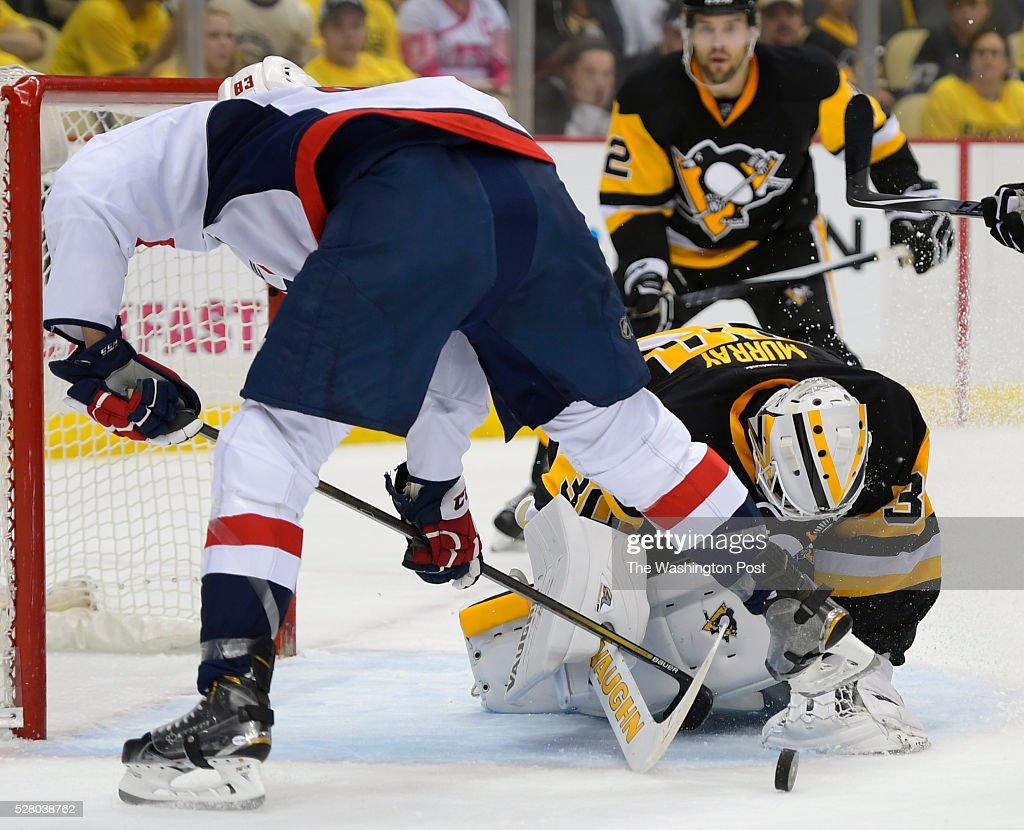 Washington center Jay Beagle left tries to play a defection off of Pittsburgh goalie Matt Murray during the Pittsburgh Penguins defeat of the...
