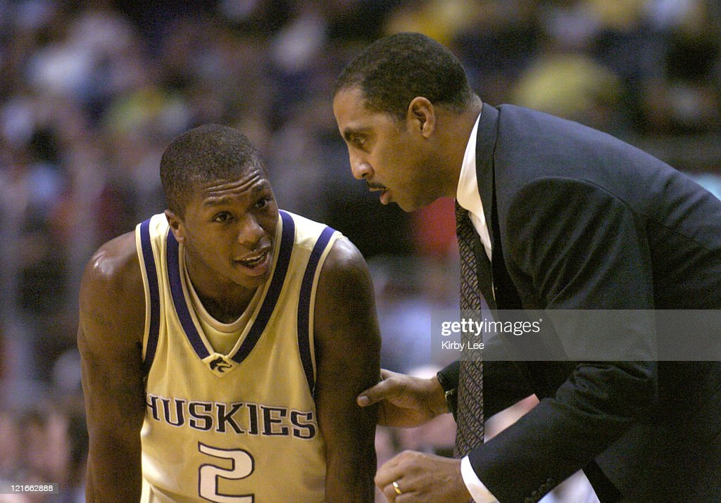 Washington coach Lorenzo Romar talks with sophomore <a gi-track='captionPersonalityLinkClicked' href=/galleries/search?phrase=Nate+Robinson&family=editorial&specificpeople=208906 ng-click='$event.stopPropagation()'>Nate Robinson</a> during 90-85 victory over Arizona in Pacific-10 Conference men's basketball tournament semifinal at the Staples Center on Friday, March 12, 2004.