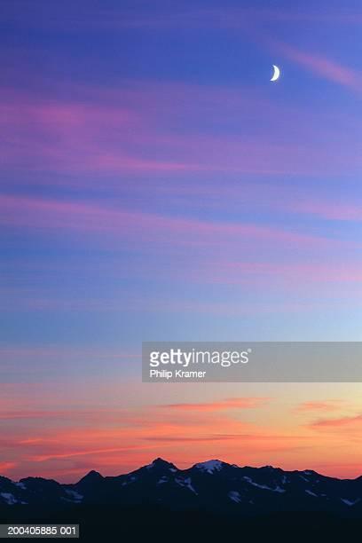 USA, Washington, crescent moon over Olympic Mountains, sunset