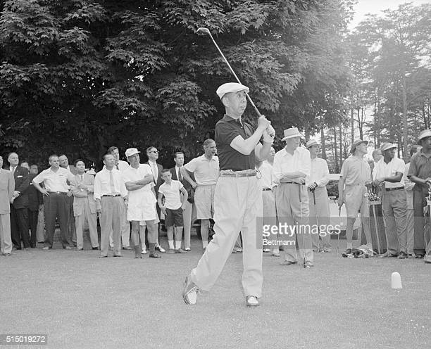 Internaitonal Friendship On The Golf Course Japanese Prime Minister Nobusuke Kishi tees off on the first hole at Burning Tree Golf Course in nearby...