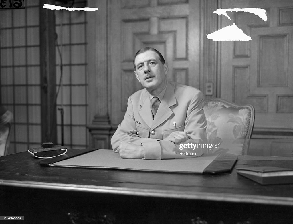 Washington, D. C.--General De Gaulle At Press Confab. This is candid view of General Charles DeGaulle, President of the French Provisional Government, while talking to newsmen at press conference in Washington. He came to the U. S. to ask aid for his country in rebuilding to former status.