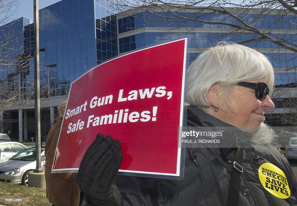 Washington, DC, area mothers and supporters join 'MomsRising' to protest and deliver 150,000 signatures to the National Rifle Association(NRA) calling for common sense gun safety laws March 14, 2014 at the NRA in Fairfax, Virginia. 'MomsRising' is an organization that mobilizes grassroots actions to make their voices heard on issues of national importance. AFP Photo/Paul J. Richards