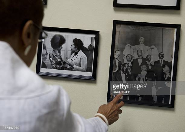 Washington DC Congressional Democratic Delegate Eleanor Holmes Norton points to a photograph of the speakers including Martin Luther King Jr from the...
