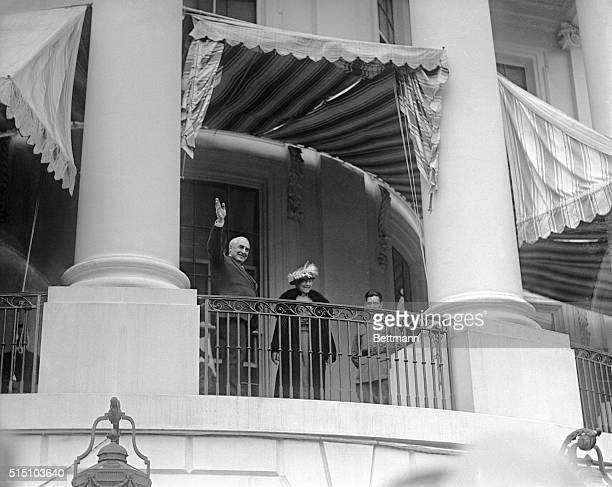 Easter egg rolling contest on White House lawn a brilliant affair President and Mrs Harding from the porch of the White House wave greetings to the...