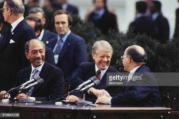 Egyptian president Anwar Sadat President Jimmy Carter and Israeli prime minister Menachem Begin attend formal ceremony on north lawn of the White...